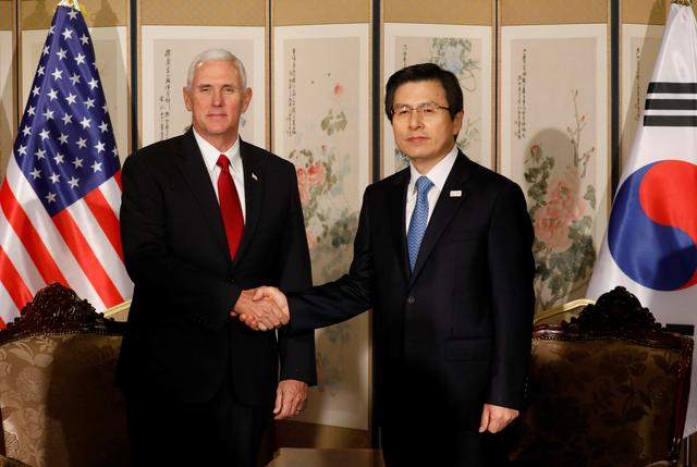 U.S. Vice President Mike Pence shakes hands with acting South Korean President and Prime Minister Hwang Kyo-ahn during their meeting in Seoul, South Korea, April 17, 2017.  REUTERS/Kim Hong-Ji