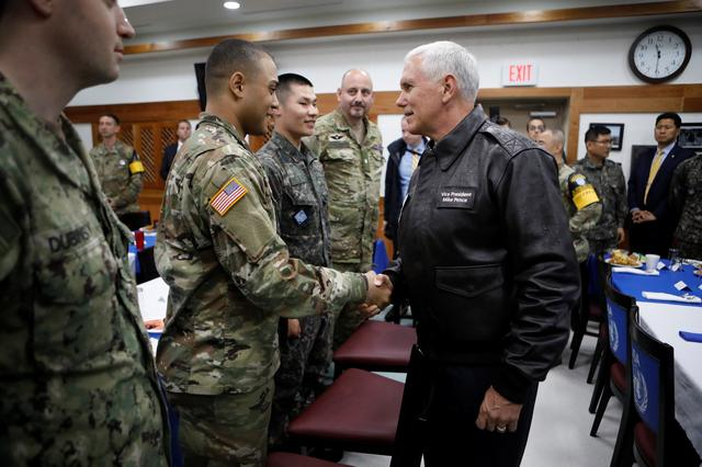 U.S. Vice President Mike Pence shakes hands with U.S. soldier during a meeting with U.S. and South Korean soldiers at Camp Bonifas near the truce village of Panmunjom, in Paju, South Korea, April 17, 2017.  REUTERS/Kim Hong-Ji