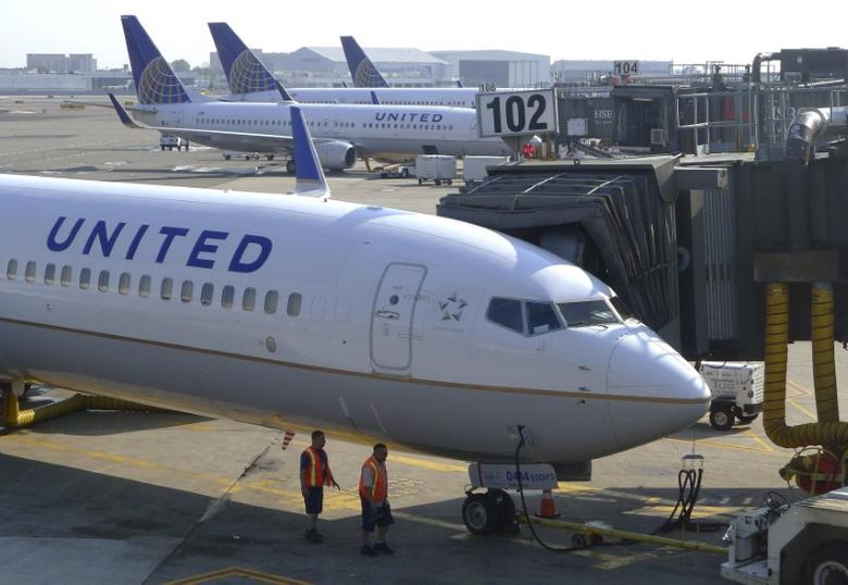 File photo: Two ground crew members walk past a United Airlines airplane as it sits at a gate at Newark Liberty International Airport in Newark, New Jersey, June 18, 2011. REUTERS/Gary Hershorn