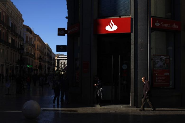 People walk past a Santander bank in downtown Malaga, southern Spain, April 1, 2016. REUTERS/Jon Nazca