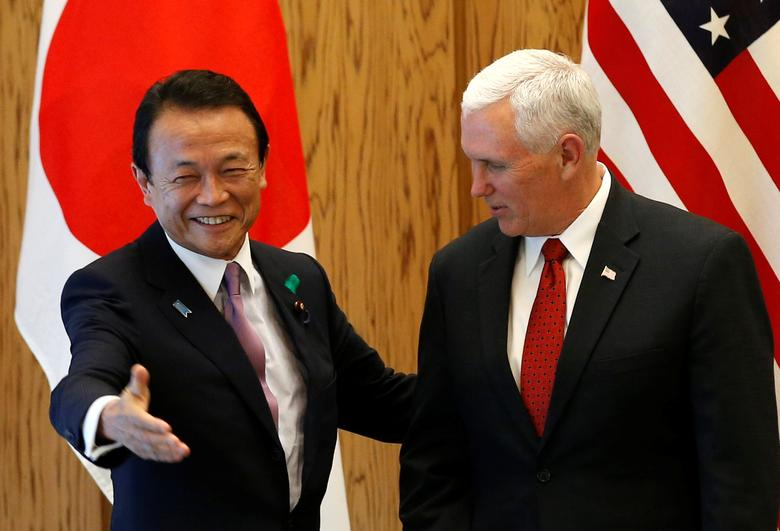 U.S. Vice President Mike Pence (R) is welcomed by Japan's Deputy Prime Minister Taro Aso at the prime minister Shinzo Abe's official residence in Tokyo, Japan April 18, 2017. REUTERS/Kim Kyung-Hoon