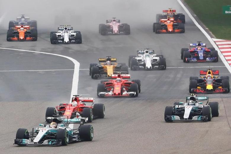 Formula One - F1 - Chinese Grand Prix - Shanghai, China - 09/04/17 - Mercedes driver Lewis Hamilton of Britain leads the race at the start of the Chinese Grand Prix at the Shanghai International Circuit. REUTERS/Aly Song