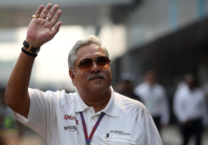Force India team principal Vijay Mallya waves in the paddock during the third practice session of the Indian F1 Grand Prix at the Buddh International Circuit in Greater Noida, on the outskirts of New Delhi, October 27, 2012.  REUTERS/Ahmad Masood/Files
