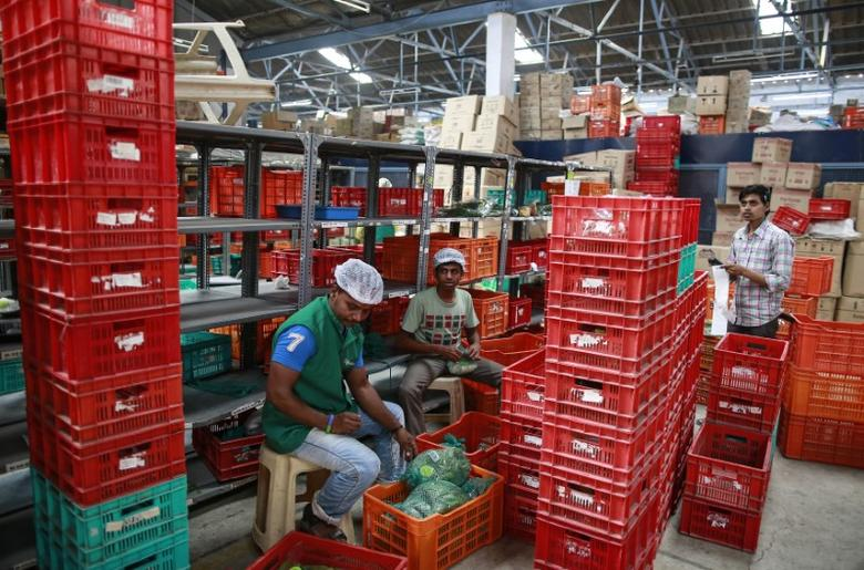 Employees sort out orders before sending them out at a Big Basket warehouse on the outskirts of Mumbai November 4, 2014. REUTERS/Danish Siddiqui