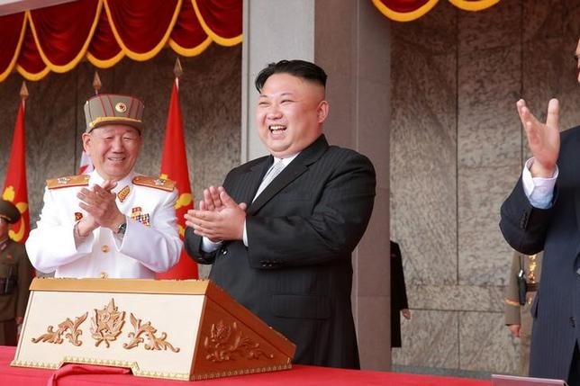 North Korean leader Kim Jong Un applauds during a military parade and a public procession of Pyongyang citizens celebrating the 105th birth anniversary of founder Kim Il Sung in this undated photo released by North Korea's Korean Central News Agency (KCNA) in Pyongyang on April 16, 2017. KCNA/via REUTERS