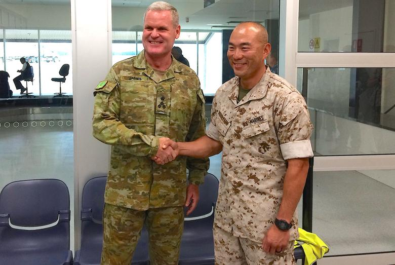 U.S. Marines commander Lieutenant Colonel Brian Middleton (R) shakes hands with Australian Army officer Brigadier Mick Ryan after arriving for the sixth annual Marines' deployment at Darwin in northern Australia, April 18, 2017. REUTERS/Tom Westbrook