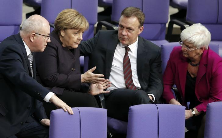 FILE PHOTO - German Chancellor Angela Merkel (2nd L) speaks with parliamentary faction leaders Volker Kauder (L-R) of the Christian Democratic Union (CDU), Thomas Oppermann of the Social Democratic Party (SPD) and chairwoman of the parliamentary state group of the Christian Social Union party (CSU) Gerda Hasselfeldt during a session of the German lower house of parliament, the Bundestag, in Berlin, Germany, November 25, 2015.   REUTERS/Fabrizio Bensch