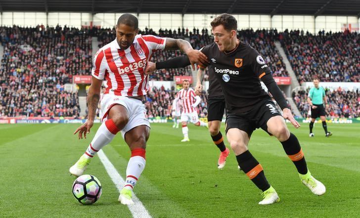 Britain Soccer Football - Stoke City v Hull City - Premier League - bet365 Stadium - 15/4/17 Stoke City's Glen Johnson in action with Hull City's Andrew Robertson  Reuters / Anthony Devlin Livepic