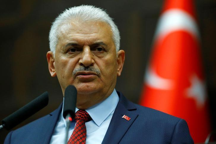 Turkey's Prime Minister Binali Yildirim addresses members of parliament from his ruling AK Party (AKP) during a meeting at the Turkish parliament in Ankara, Turkey, April 18, 2017. REUTERS/Umit Bektas