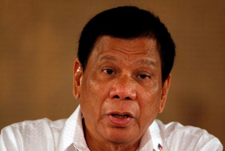 Philippine President Rodrigo Duterte speaks during a news conference at the presidential palace in Manila, Philippines March 13, 2017. REUTERS/Erik De Castro/Files