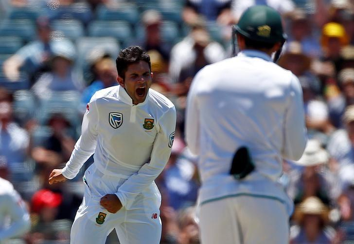 Cricket - Australia v South Africa - First Test cricket match - WACA Ground, Perth, Australia - 4/11/16 South Africa's Keshav Maharaj celebrates after dismissing Australia's captain Steve Smith LBW at the WACA Ground in Perth.    REUTERS/David Gray/Files