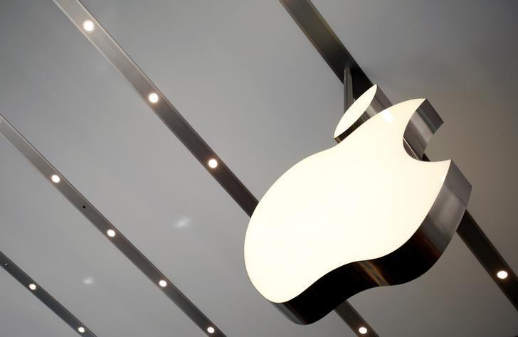 FILE PHOTO: The Apple logo is pictured inside the newly opened Omotesando Apple store at a shopping district in Tokyo June 26, 2014. REUTERS/Yuya Shino/File Photo