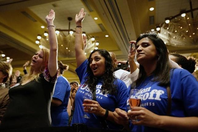 Supporters of Jon Ossoff cheer as speakers rally for Ossoff as the Georgia's Sixth District Congressional candidate Jon Ossoff's Election Night party in Sandy Springs, Georgia, U.S., April 18, 2017.    REUTERS/Marvin Gentry
