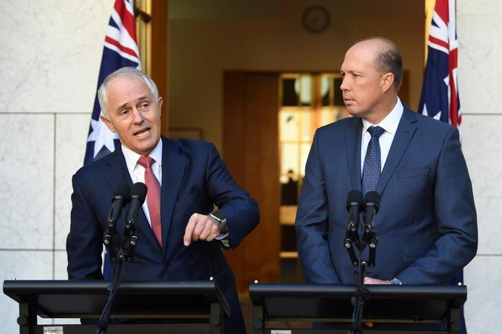 Australia's Prime Minister Malcolm Turnbull (L) and Minister for Immigration and Border Protection Peter Dutton speak on Australia's citizenship test during a press conference at Parliament House in Canberra, Australia, April 20, 2017.  AAP/Lukas Coch/via REUTERS