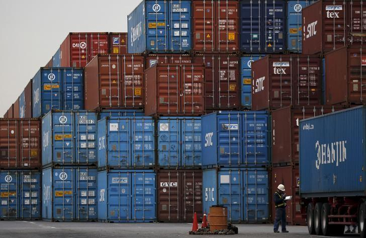 A laborer works in a container area at a port in Tokyo, Japan, March 16, 2016.  Japan's exports fell 4.0 percent in February from a year earlier, which was slower than a decline in the previous month, but economists worry that a renewed slowdown in emerging markets could curb future export growth.  REUTERS/Toru Hanai