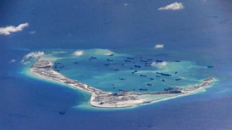 FILE PHOTO: Chinese dredging vessels are purportedly seen in the waters around Mischief Reef in the disputed Spratly Islands in the South China Sea in this still image from video taken by a P-8A Poseidon surveillance aircraft provided by the United States Navy May 21, 2015.  U.S. Navy/Handout via Reuters