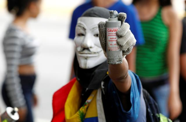 An opposition demonstrator shows a tear gas grenade while clashing with riot police during the so called ''mother of all marches'' against Venezuela's President Nicolas Maduro in Caracas, Venezuela, April 19, 2017. REUTERS/Christian Veron