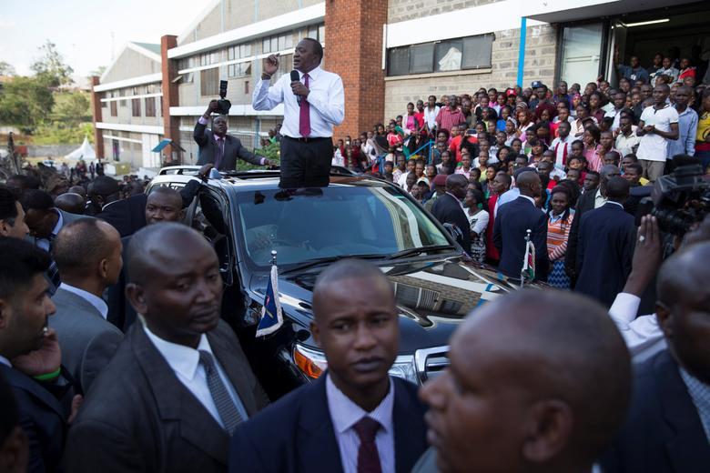 FILE PHOTO: Kenya's President Uhuru Kenyatta delivers a speech during a visit to the United Aryan Export Processing Zone textile factory in Nairobi, Kenya, April 12, 2017. REUTERS/Baz Ratner
