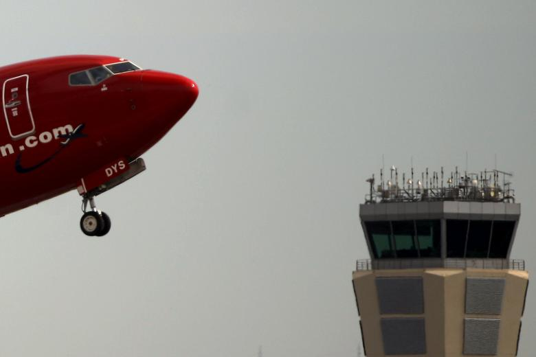 FILE PHOTO: A Norwegian aircraft takes off past the air traffic control tower of Pablo Ruiz Picasso Airport in Malaga, southern Spain, June 8, 2015. REUTERS/Jon Nazca /File Photo