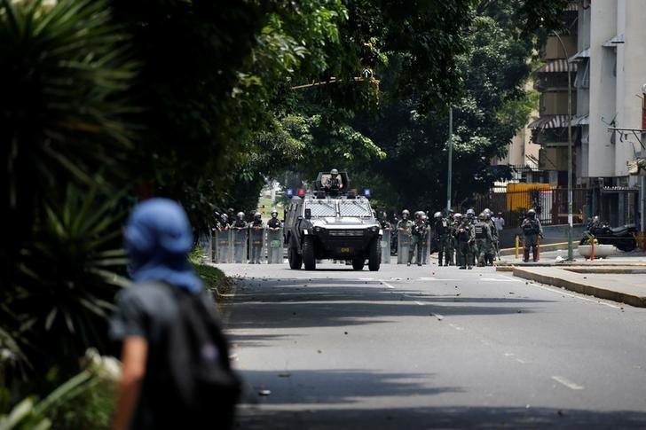 A demonstrator rallies against Venezuela's President Nicolas Maduro in Caracas, Venezuela, April 20, 2017. REUTERS/Carlos Garcia Rawlins