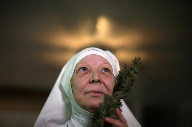 California ''weed nun'' Christine Meeusen, 57, who goes by the name Sister Kate, poses for a portrait with hemp at Sisters of the Valley near Merced, California, U.S., April 18, 2017. REUTERS/Lucy Nicholson