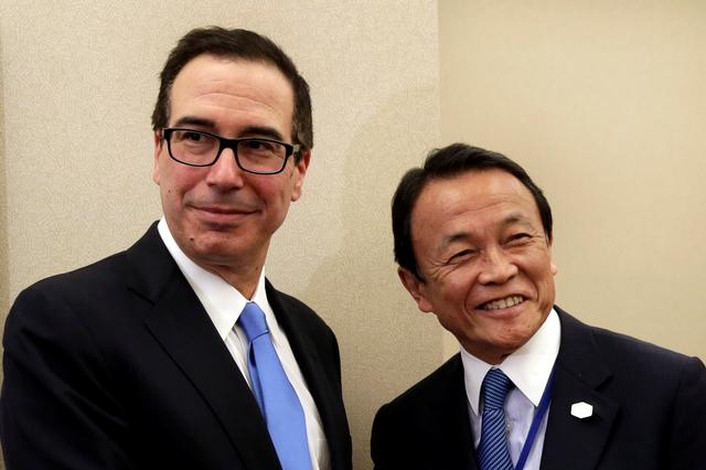U.S. Treasury Secretary Steven Mnuchin (L) meets with Japanese Finance Minister Taro Aso meeting during the IMF/World Bank spring meetings in Washington, U.S., April 20, 2017. REUTERS/Yuri Gripas