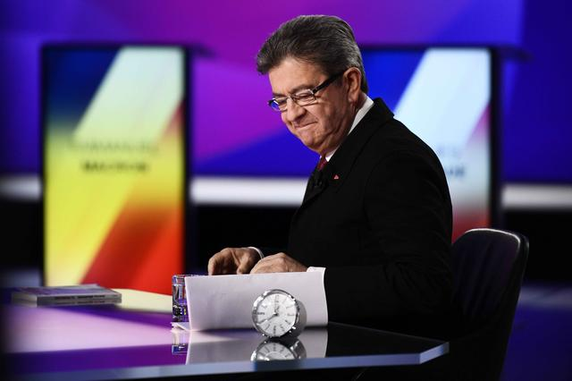 Jean-Luc Melenchon of the French far left Parti de Gauche and candidate for the 2017 French presidential election, takes his seat in the the studios of France 2 television station during the special prime time political show, ''15min to Convince'' in Saint-Cloud, near Paris, France, April 20, 2017. REUTERS/Martin Bureau/Pool