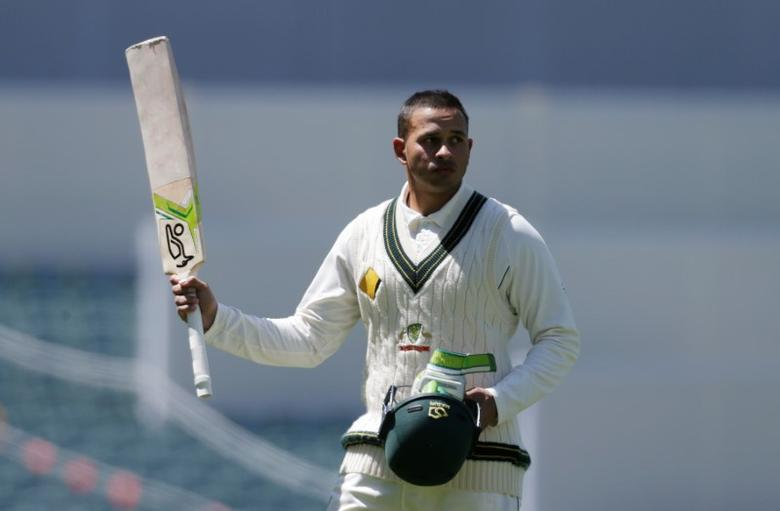 FILE PHOTO - Cricket - Australia v South Africa - Third Test cricket match - Adelaide Oval, Adelaide, Australia - 26/11/16.  Australian batsman Usman Khawaja acknowledges the crowd as he walks off the field after being dismissed during the third day of the Third Test cricket match in Adelaide.  REUTERS/Jason Reed