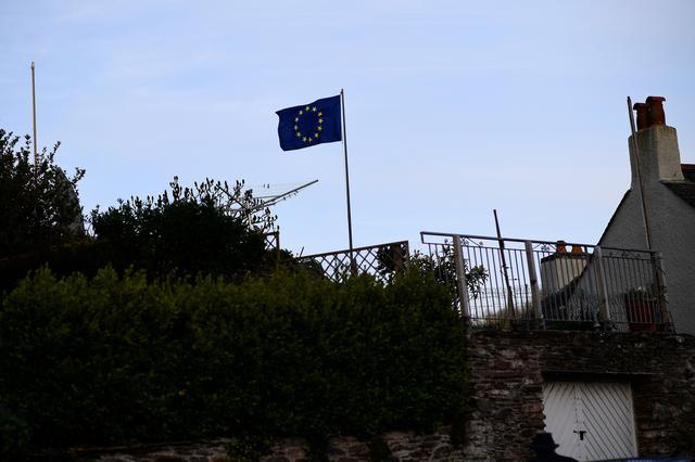 An EU flag flutters outside a house in Newton Ferrers, Devon, Britain April 11, 2017. REUTERS/Dylan Martinez