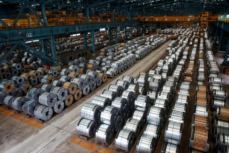 FILE PHOTO: Rolls of steel are stacked inside the China Steel Corporation factory, in Kaohsiung, southern Taiwan August 26, 2016. REUTERS/Tyrone Siu/File Photo