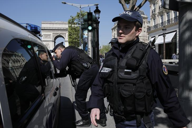 French police patrol the Champs Elysees Avenue the day after a policeman was killed and two others were wounded in a shooting incident in Paris, France, April 21, 2017. REUTERS/Benoit Tessier
