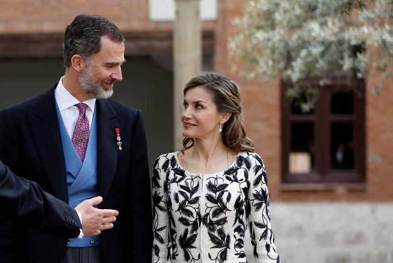 Spain's Queen Letizia and Spain's King Felipe look at each other as they prepare for a family photo with Spanish writer Eduardo Mendoza (not pictured) after Mendoza received the ''Premio Cervantes'' Literature Award at the University of Alcala de Henares, near Madrid, Spain April 20, 2017. REUTERS/Susana Vera