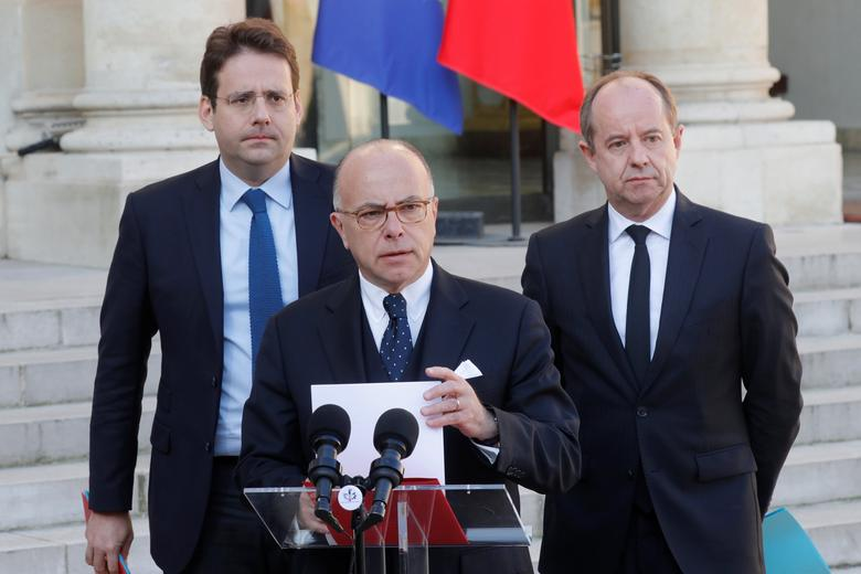 French Prime Minister Bernard Cazeneuve (C), Justice Minister Jean-Jacques Urvoas (R) and Interior Minister Matthias Fekl speak at the end of a defence council at the Elysee Palace in Paris, France, April 21, 2017.   REUTERS/Philippe Wojazer