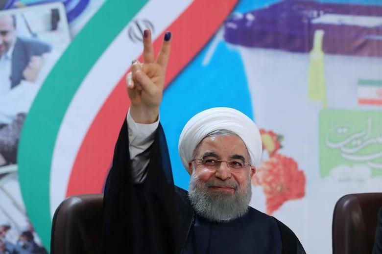 FILE PHOTO: Iran's President Hassan Rouhani gestures as he registers to run for a second four-year term in the May election, in Tehran, Iran, April 14, 2017. President.ir/Handout via REUTERS