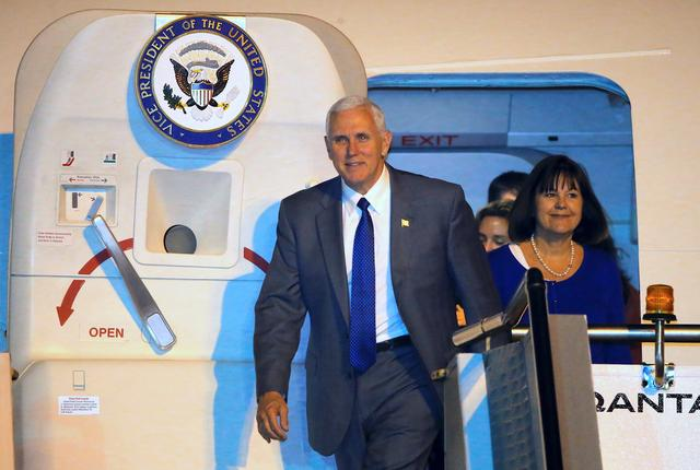 U.S. Vice President Mike Pence walks out of his plane with wife Karen after arriving at Sydney International Airport in Australia, April 21, 2017.  REUTERS/Jason Reed