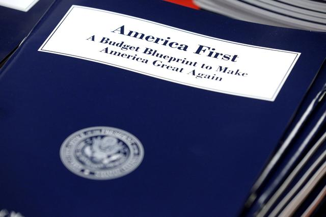 FILE PHOTO: U.S. President Donald Trump's overview of the budget priorities for Fiscal Year 2018 are displayed at the U.S. Government Publishing Office (GPO) on its release by the Office of Management and Budget (OMB) in Washington, U.S. on March 16, 2017.      REUTERS/Joshua Roberts/File Photo