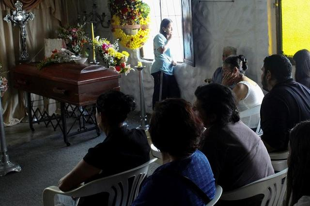 Mourners attend the wake of Paola Ramirez, a student who died during a protest, in San Cristobal, Venezuela, April 20, 2017. REUTERS/Carlos Eduardo Ramirez