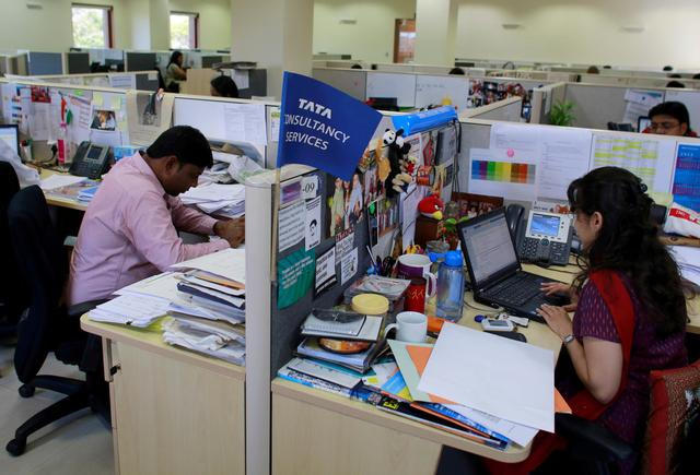 FILE PHOTO: Employees of Tata Consultancy Services (TCS) work inside the company headquarters in Mumbai, India, March 14, 2013. REUTERS/Danish Siddiqui/File Photo