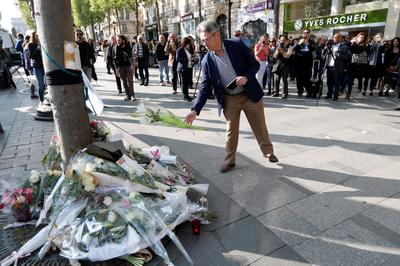 Shooting on Champs Elysees in Paris
