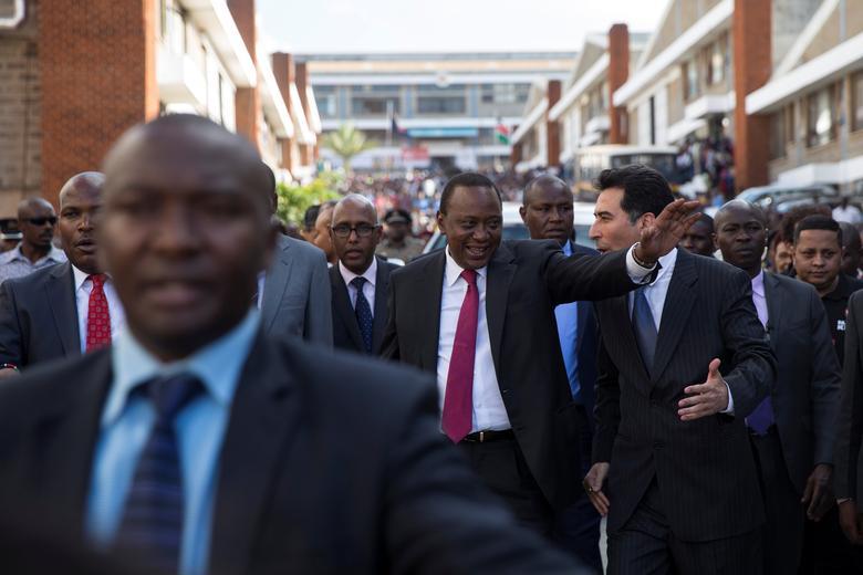 Kenya's President Uhuru Kenyatta gestures as he arrives for visit to the United Aryan Export Processing Zone textile factory in Nairobi, Kenya, April 12, 2017. REUTERS/Baz Ratner