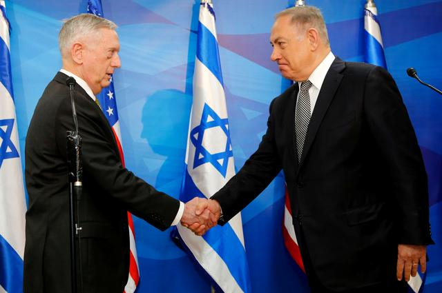 Israeli Prime Minister Benjamin Netanyahu (R) shakes hands with US Defence Secretary James Mattis before their meeting in Jerusalem April 21, 2017. REUTERS/Gil Cohen-Magen/Pool