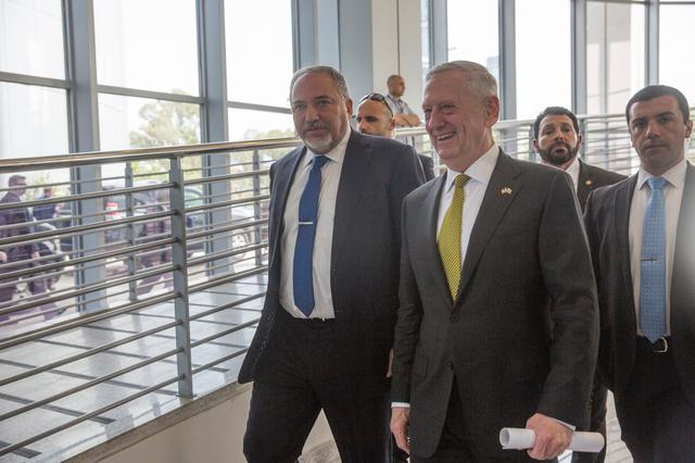 IsraelÕs Minister of Defense Avigdor Lieberman (L) and U.S. Defense Secretary James Mattis walk after they held a joint news conference at the Ministry of Defense in Tel Aviv, Israel, April 21, 2017 REUTERS/Heidi Levine/ Pool