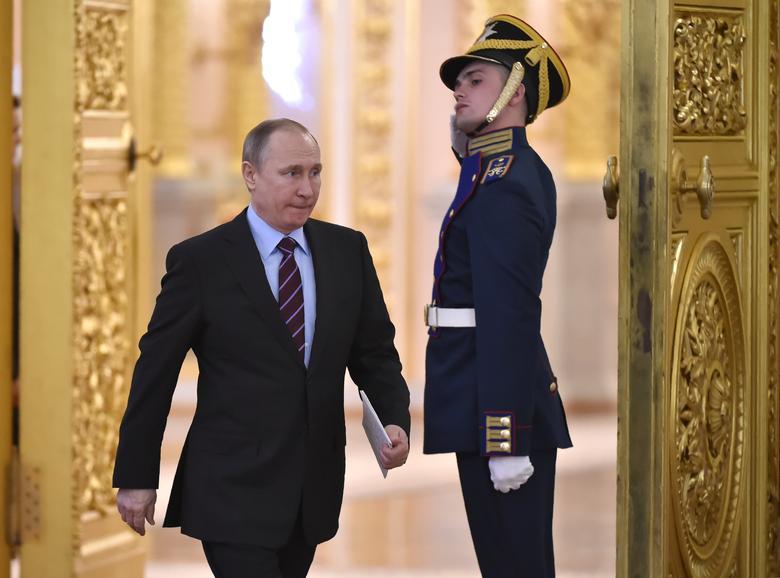 Russia's President Vladimir Putin arrives to chair a meeting at the Kremlin. REUTERS/Alexander Nemenov/Pool
