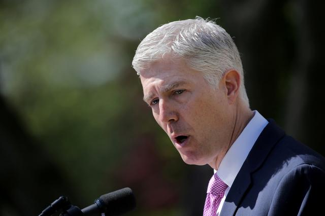 FILE PHOTO: Judge Neil Gorsuch speaks after his swearing as an associate justice of the Supreme Court in the Rose Garden of the White House in Washington, U.S., April 10, 2017. REUTERS/Carlos Barria/File Photo