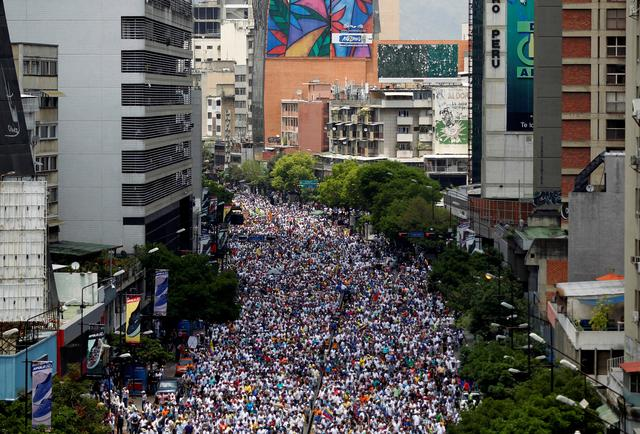 FILE PHOTO: Opposition supporters rally against Venezuela's President Nicolas Maduro in Caracas, Venezuela. REUTERS/Christian Veron