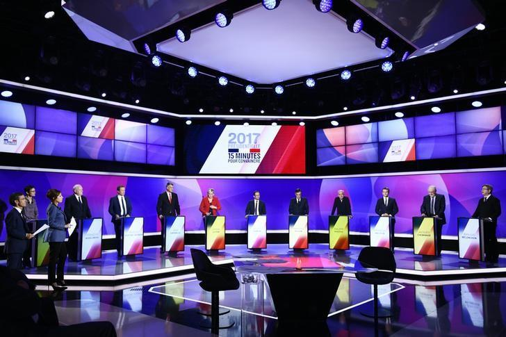The eleven French presidential election candidates take part in a special political television show entitled ''15min to Convince'' at the studios of French Television channel France 2 in Saint-Cloud, near Paris, April 20, 2017.  REUTERS/Martin Bureau/Pool/Files