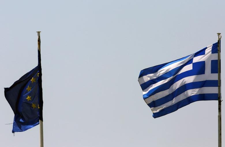 A Greek and a tangled EU flag flutter atop Greece's Financial Ministry in Athens, Greece June 24, 2016 after Britain voted to leave the European Union in the Brexit referendum. REUTERS/Yannis Behrakis