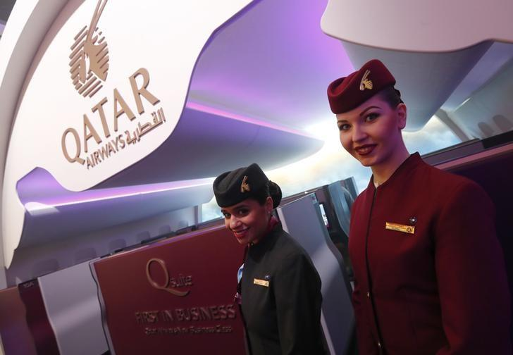 Qatar Airways stewardesses pose at the International Tourism Trade Fair ITB in Berlin, Germany, March 8, 2017.      REUTERS/Fabrizio Bensch