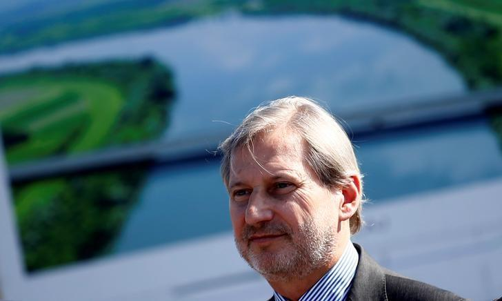 European Union (EU) Enlargement Commissioner Johannes Hahn attends an opening ceremony at the EU-funded cross-border bridge, in Donji Svilaj, Bosnia and Herzegovina March 17, 2017. REUTERS/Dado Ruvic