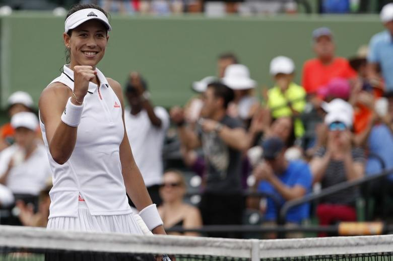 Mar 25, 2017; Miami, FL, USA; Garbine Muguruza of Spain celebrates after winning match point against Shuai Zhang of China (not pictured) on day five of the 2017 Miami Open at Crandon Park Tennis Center. Muguruza won 4-6, 6-2, 6-2. Mandatory Credit: Geoff Burke-USA TODAY Sports/File Photo